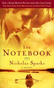 Cover of the Nicholas Sparks novel The Notebook, featuring Ryan Gosling preparing to kiss Rachel McAdams.