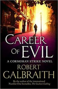 The cover of Robert Galbraith's novel, Career of Evil, featuring a moody photograph of a long figure walking on a street alone.